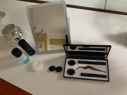 Lashify's Intimate Lash collection contents spread out on a table.
