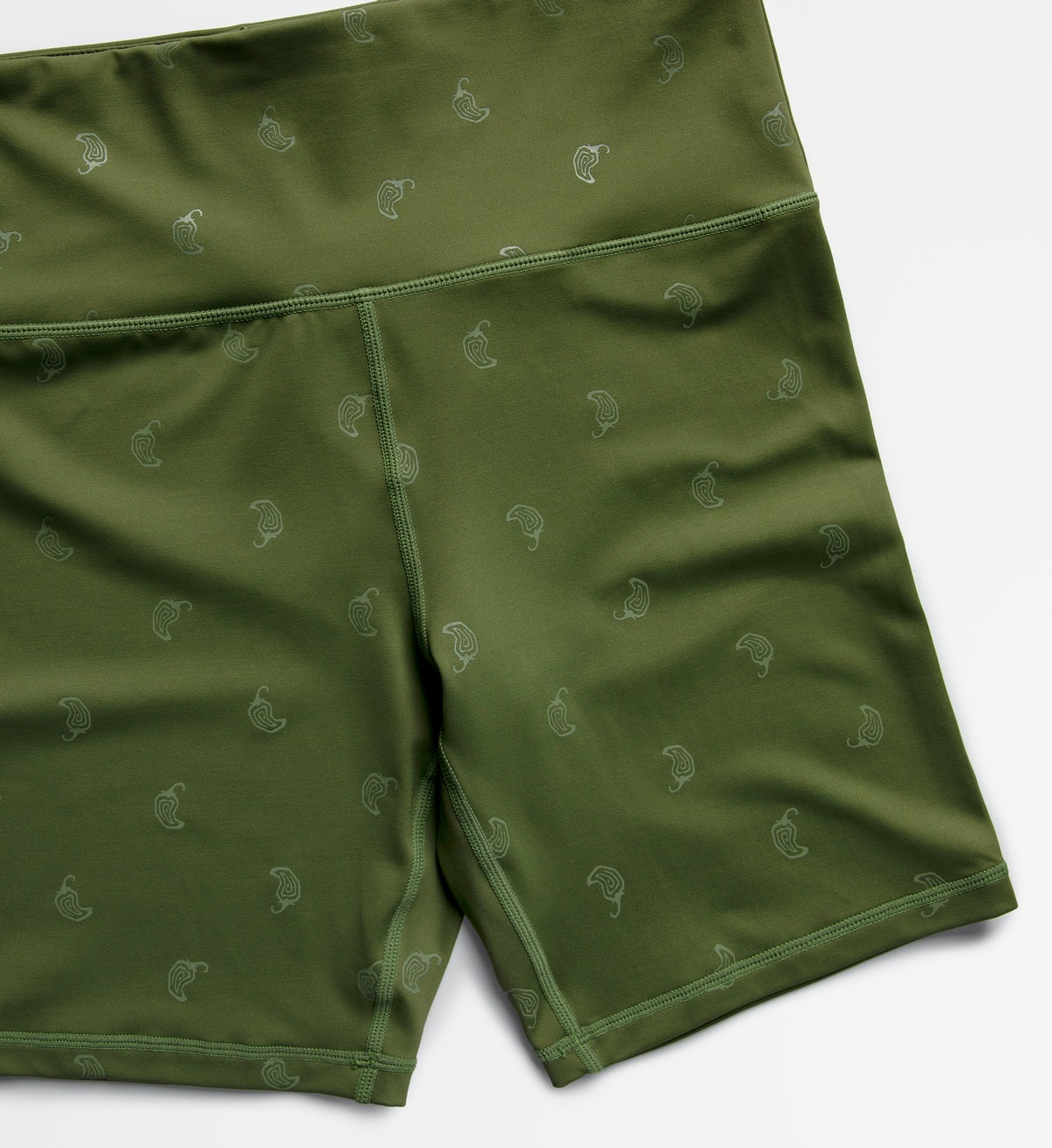 Chipotle's activewear line with bike shorts and leggings includes green and black shades.