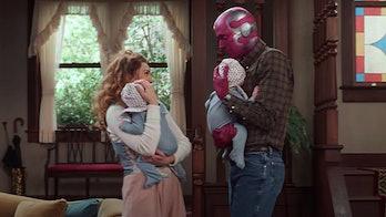 Elizabeth Olsen and Paul Bettany holding babies in WandaVision