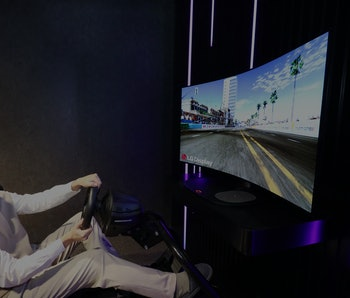 A gamer sits in front of a curved LG display.