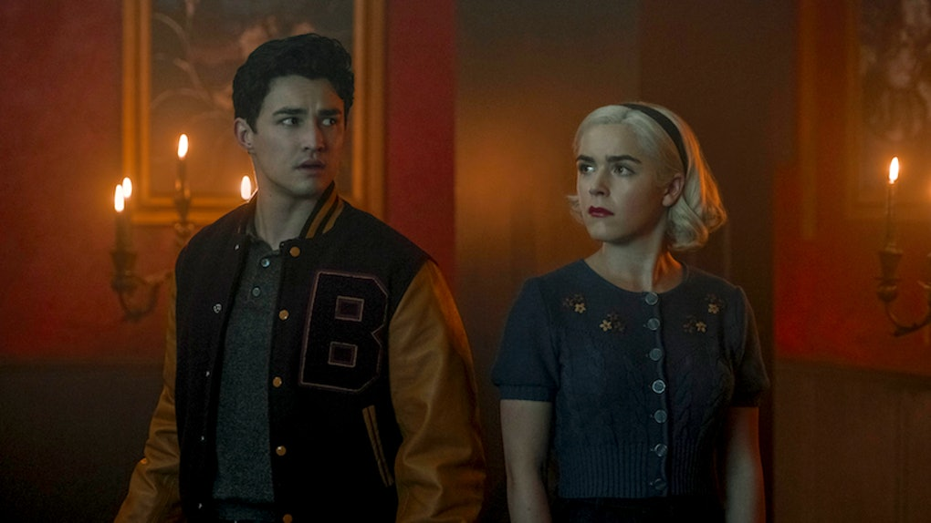 Sabrina and Nick from the 'Chilling Adventures of Sabrina' on Netflix stand together.