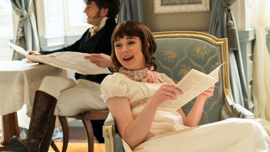 Eloise laughs while reading Lady Whistledown's paper in 'Bridgerton.'