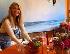 Christie Brinkley's dining room features the mismatched dining chair trend