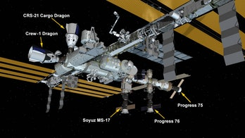 Illustration of International Space Station with multiple docked space craft including SpaceX CRS-21
