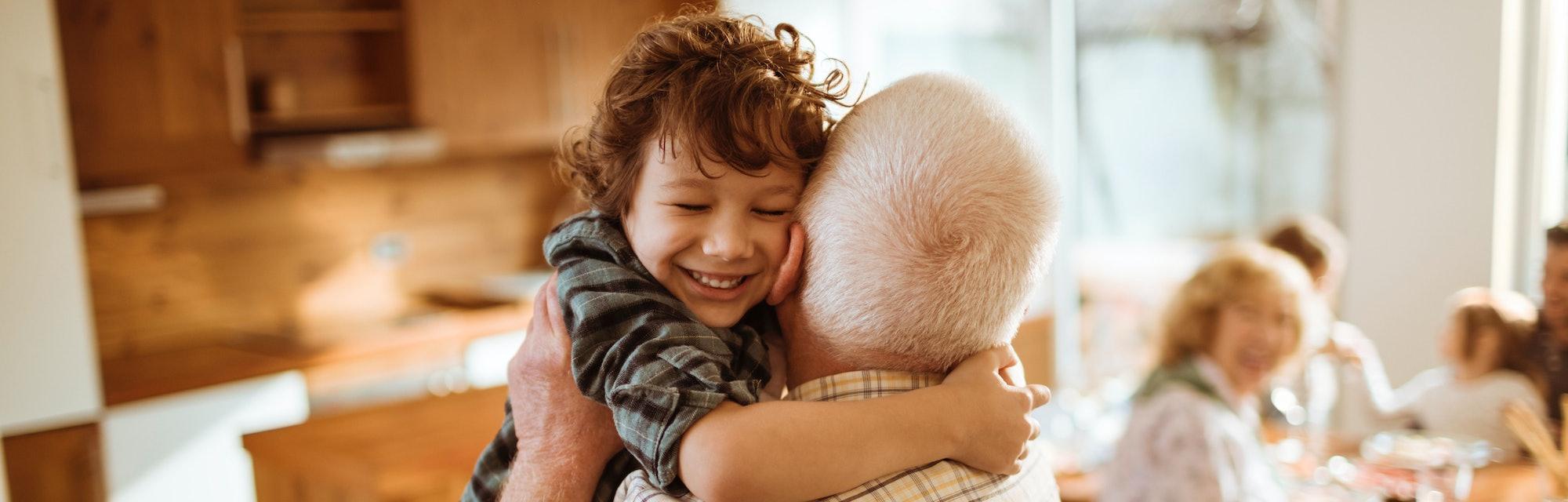 little boy hugging grandparent