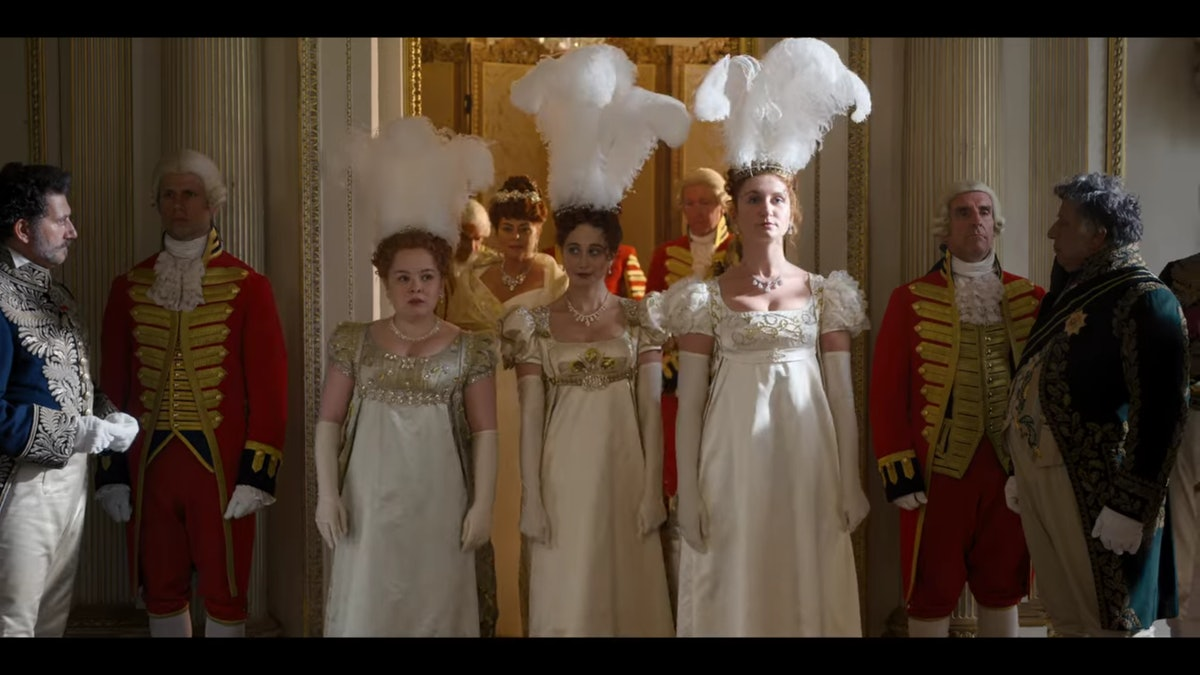 """Penelope, Philipa, and Prudence Featherington appearing before the Queen in episode one of """"Bridgerton."""""""