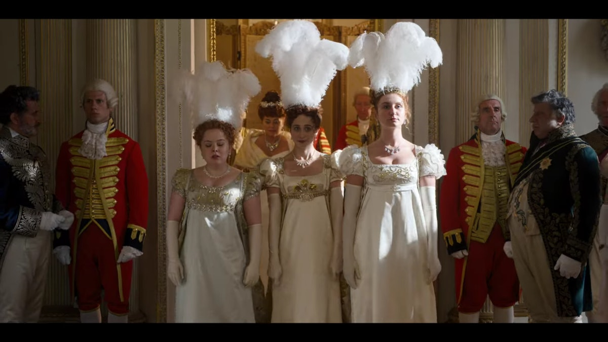 """Penelope, Philippa, and Prudence Featherington being presented to the Queen in episode one of """"Bridgerton."""""""