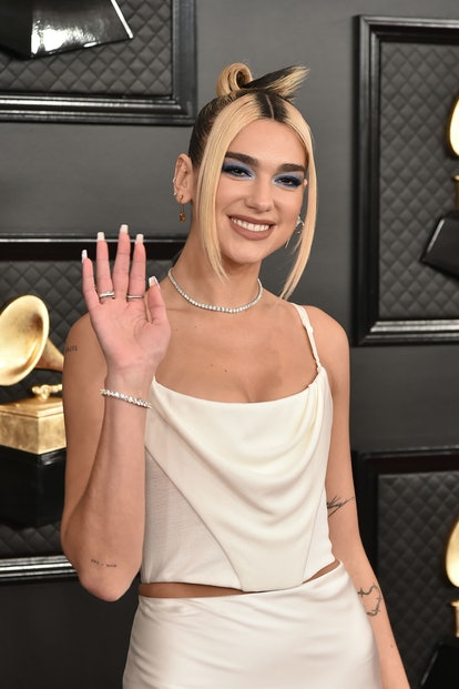 Dua Lipa has been seen with high contract hair colors, another '90s beauty trend.