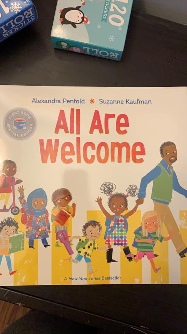 A copy of the book All Are Welcome by Alexandra Penfold and Suzanne Kaufman