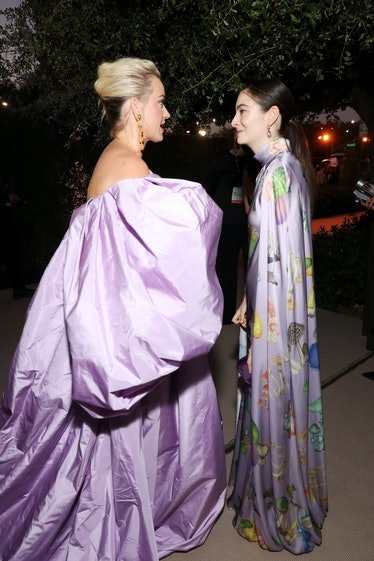 Katy Perry and Lorde wearing lilac statement dresses