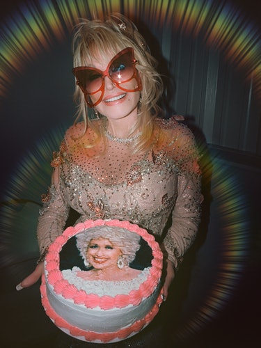 Parton wears her own custom dress by Steve Summers; Marc Jacobs sunglasses; Chopard earrings and rin...