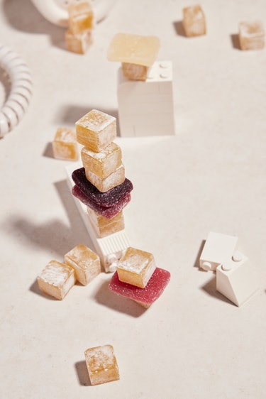 gummies in various colors and sizes artfully arranged with white Legos