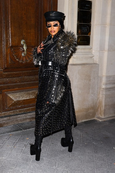 Cardi B in a spiked and studded leather outfit giving vibes of macho biker guy.