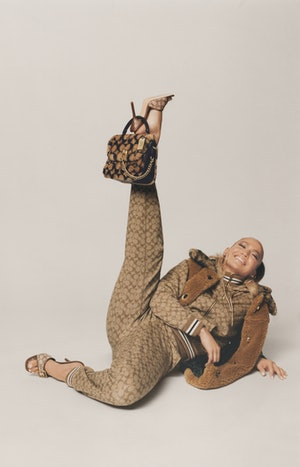 Jennifer Lopez does her signature dance move for her campaign with Coach.