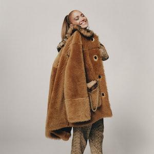 Jennifer Lopez wearing a coat from the Jennifer Lopez X Coach collaboration.