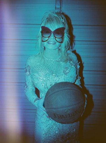 Dolly Parton wears her own custom dress by Steve Summers; Marc Jacobs sunglasses; Chopard earrings; ...