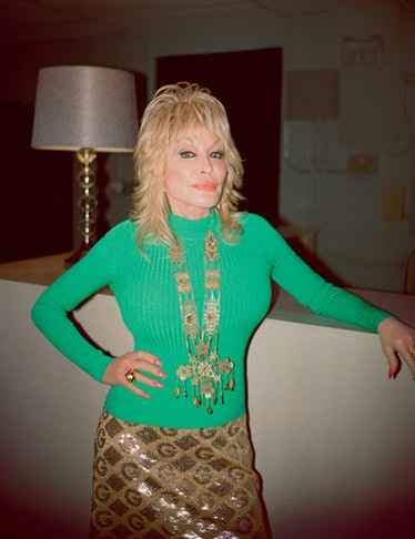 Dolly Parton wears a Gucci turtleneck, skirt, necklace, and rings; her own earrings.