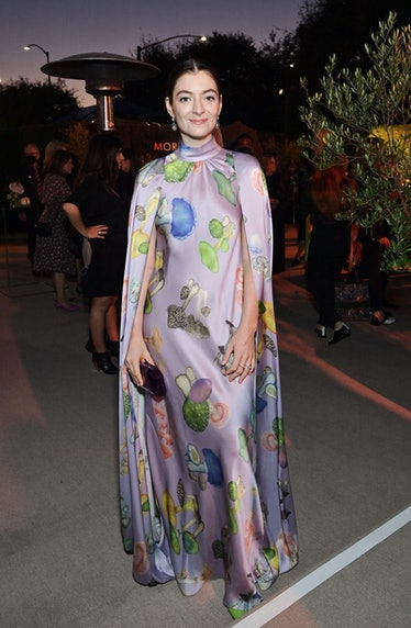 Lorde wearing a mushroom-covered cape gown by Rodarte