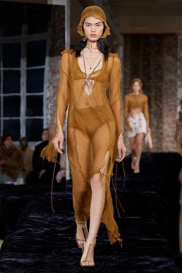 Model walks in Acne Spring 2022 show at Paris Fashion Week.