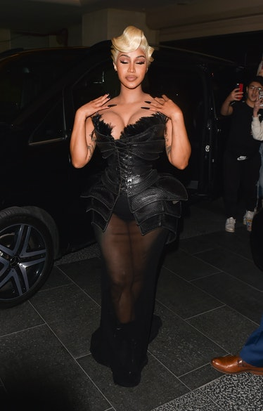 Cardi B in black leather Mugler dress.