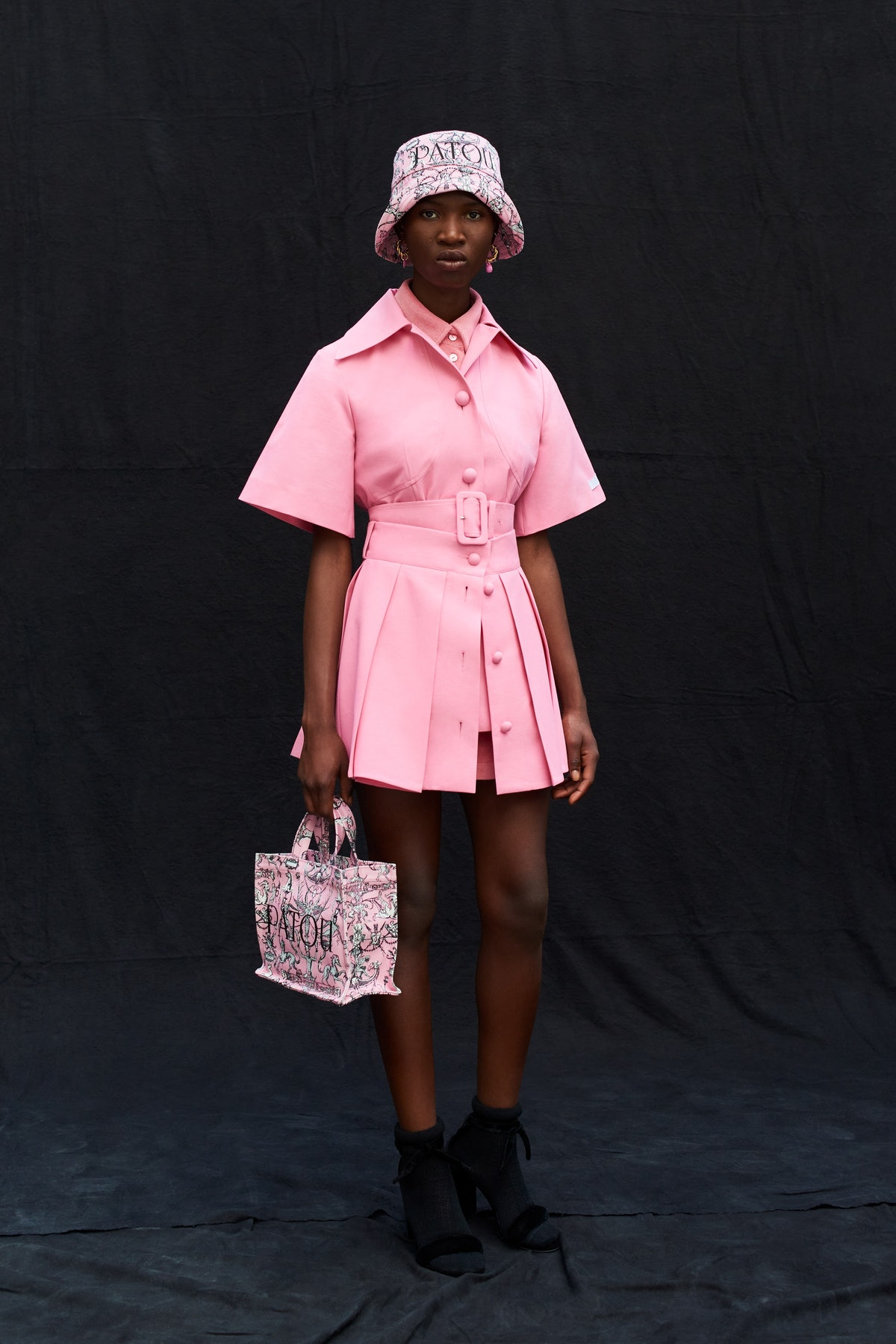 Model wears pink dress and hat from Patou's spring 2022 collection.
