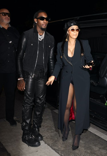Cardi B in black coat and beret.