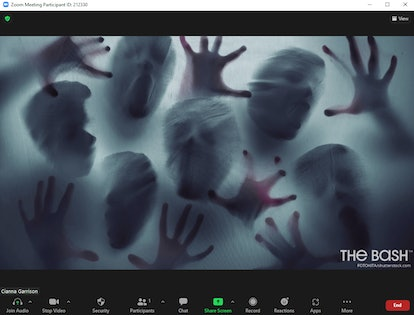 This scary Halloween Zoom background includes ghostly figures through a window.