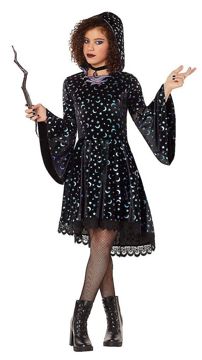 Kid posing in witch costume with hood