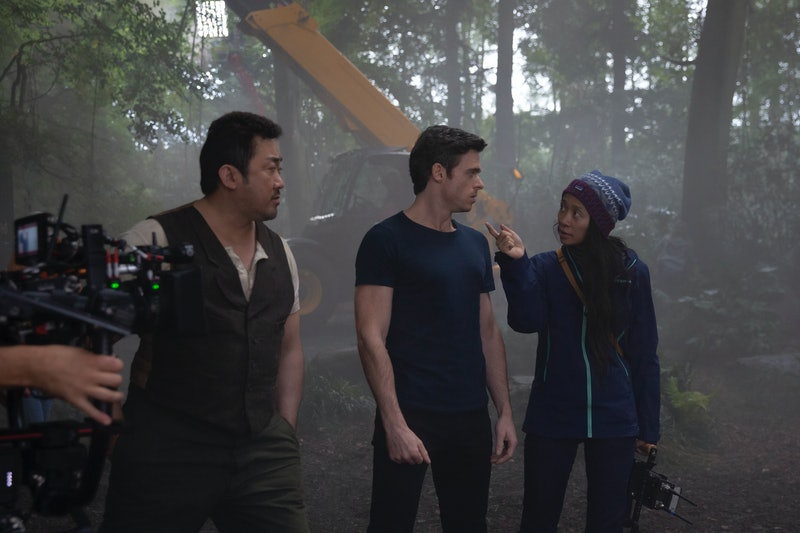 Don Lee, Richard Madden and director Chloé Zhao behind the scenes of Marvel Studios' 'Eternals.'