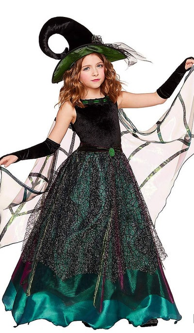 Little girl posing in green gown/witch costume