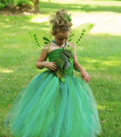 Girl wearing a green fairy costume