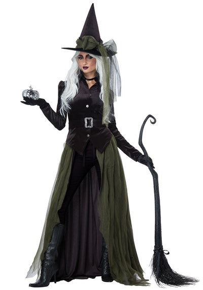 Adult woman posing in witch costume