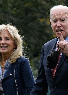 Dr. Jill and President Joe Biden, walking.