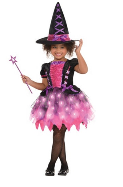 Girl posing in pink witch costume