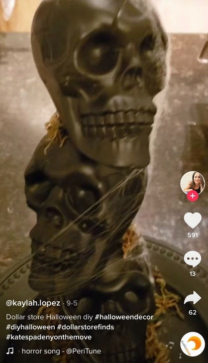 A woman shows off her best dollar store decor hacks for Halloween on TikTok with these stacked skull...