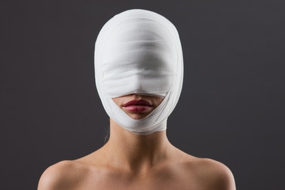 Woman with face wrapped in gauze