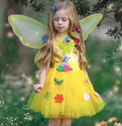 Girl wearing butterfly fairy costume