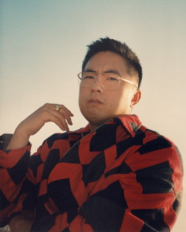 Bowen Yang in red and black jacket.