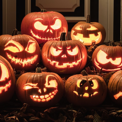 Several jack-o-lanterns stacked together, displayed on a table