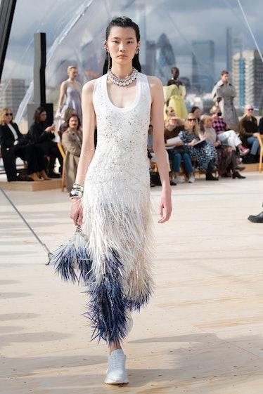 Model walks in Alexander McQueen spring 2022 show.