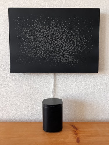 Symfonisk Picture Frame speaker next to a Sonos One.