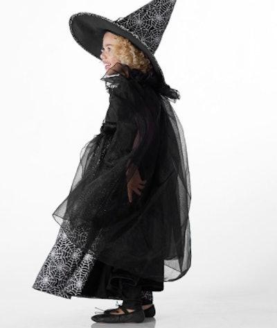 Girl dressed in glow in the dark wizard costume