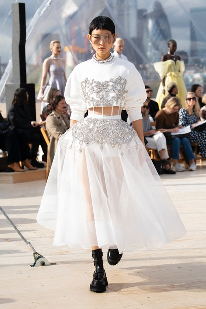 Model walks in Alexander McQueen Spring 2022 show in London.