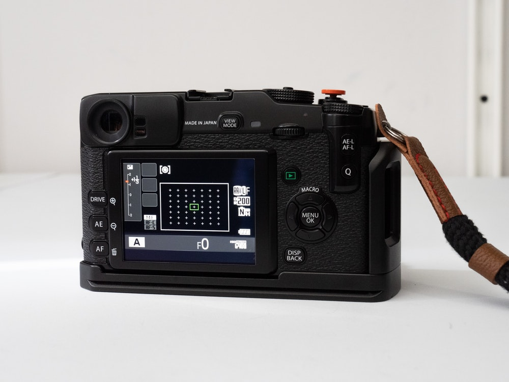 The X-Pro1 in an aluminum grip.
