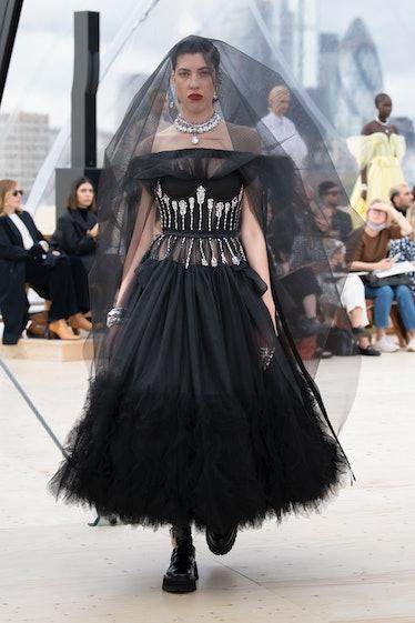 Model walks in Alexander McQueen's spring 2022 show.