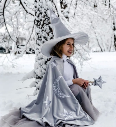 Girl wearing a snow wizard costume