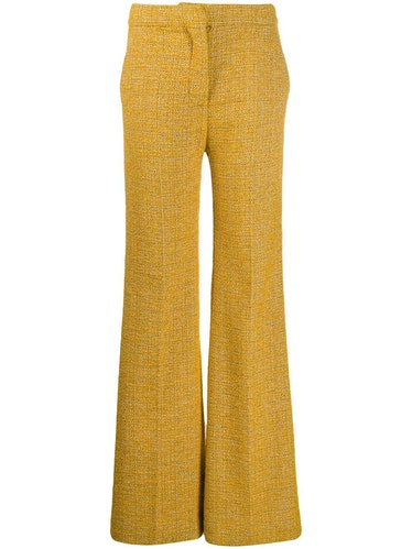 Victoria Beckham's yellow trousers.