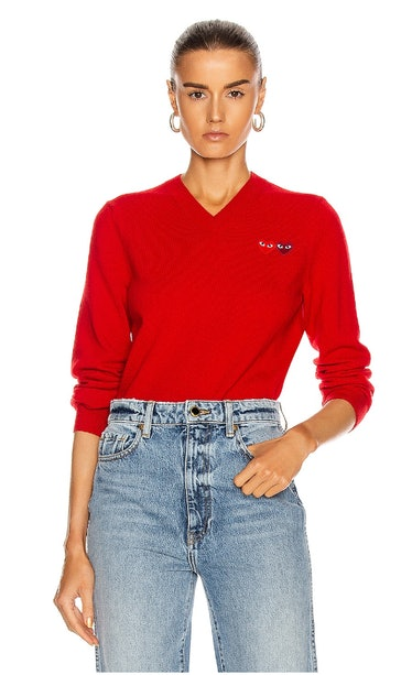 Red Comme des Garçons knit sweater.