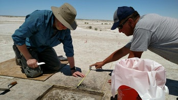 Researchers dig at the Wishbone site, where ancient tobacco use was discovered.