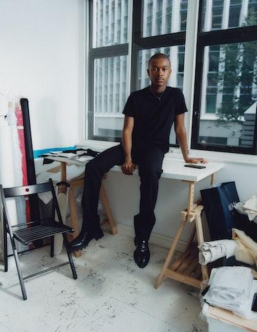 Designer Maximilian Davis in black t-shirt and pants.